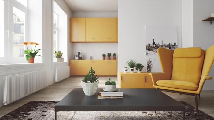 cuisine ouverte sur salon, déco scandinave blanche, avec des accents jaune moutarde, façade cuisine, meuble rangement et canapé jaune, table basse noire, tapis noir et gris