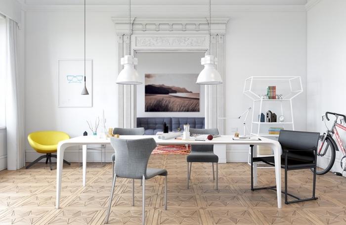 meubles scandinaves dans un salon, table blanche, chaises grises, suspensions blanches, fauteuil jaune et mur couleur blanche, étagère design originale, revêtement sol bois