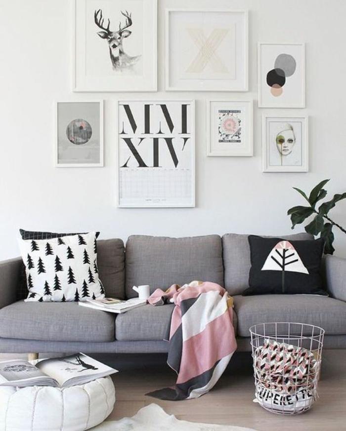 deco salon moderne, sofa gris scandinave, plaid en rose et blanc, coussins aux motifs scandinaves