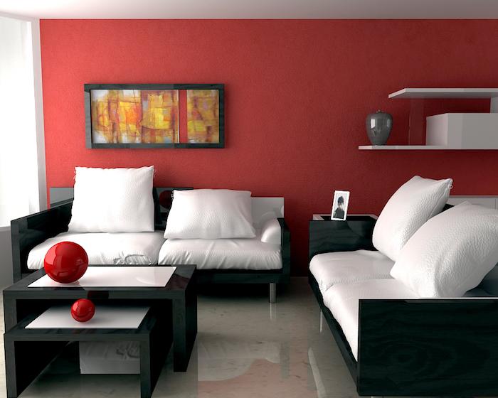 idée de peinture rouge salon, deco rouge et noir, canapés noirs, coussins d assise blancs, tables basses en noir et blanc