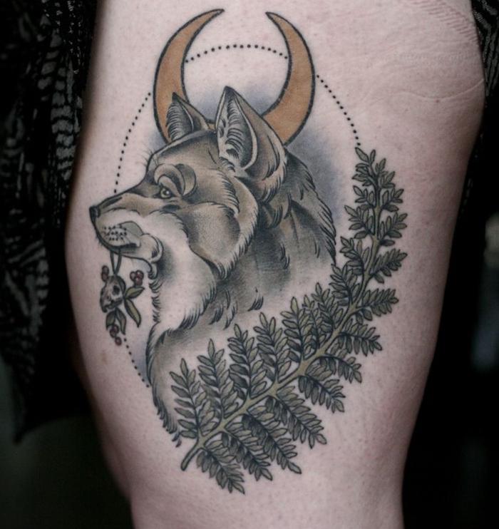 signification tatouage, art corporel pour femme, tattoo en couleurs sur jambe à design loup