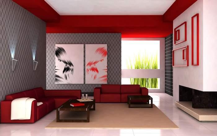 accord de couleurs, idée de mur gris, revêtement sol carrelage blanc, canapés rouges, tapis beige, deco murale portraits, mur de cadres vides rouges