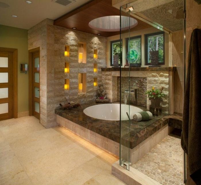 idee salle de bain, bougies led mises dans des niches murales, baignoire ronde fantastique