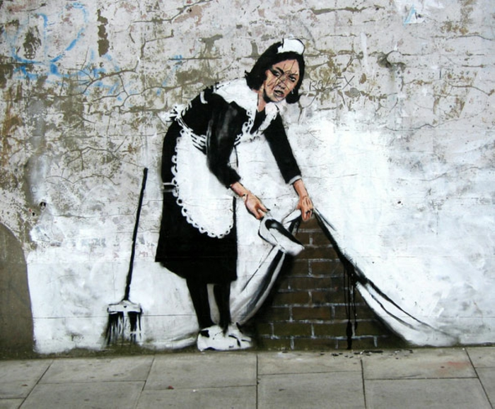 Street art Bansky graffiti dessiner une femme de profil dessin humoristique maitre