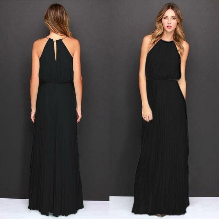 robe fluide, jolie robe noire, coiffure ondulante, jupe plissée noire, top original