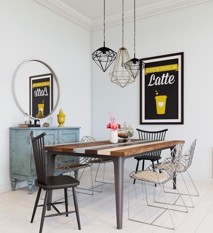 déco salle à manger dans une maison scandinave, table en bois, chaises bois et metal, commode bleu patiné, deco murale graphique et jaune, suspensions originales