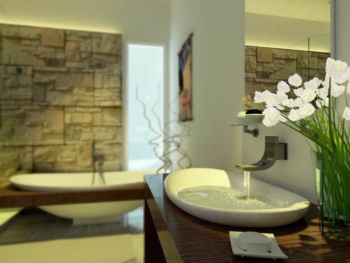 salle de bain cocooning, vasque à poser blanche, décoration avec orchidée, parement pierre naturelle, baignoire moderne