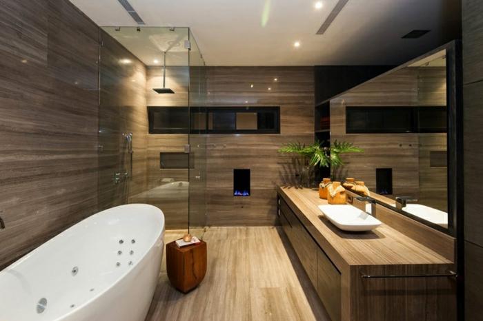 salle de bain nature, baignoire ovale blanche, sol en bois, meuble de salle de bains simple