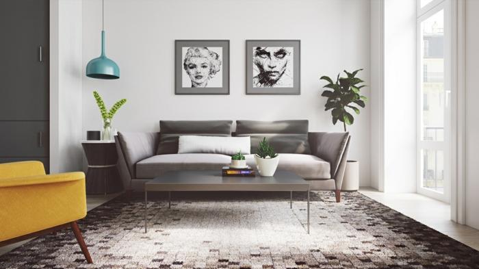 amenagement salon inspiration scandinave, canapé et table basse gris, tapis scandinave noir, blanc et gris, fauteuil jaune moutarde, deco murale dessins graphiques