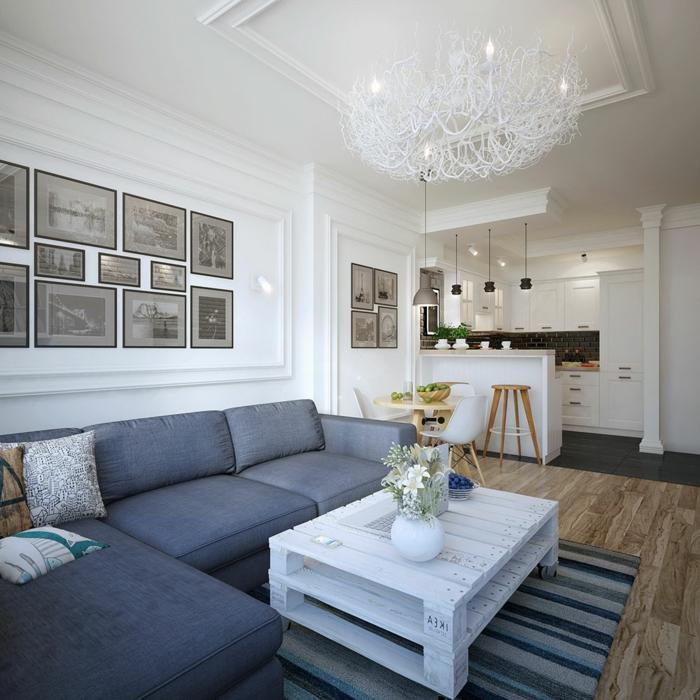 inspiration scandinave pour décorer un salon nordique, canapé gris anthracite, table basse en palette, bar et façade cuisine blanche, suspension design, deco murale photos en noir et blanc