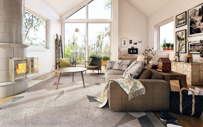 meuble vintage et canapé couleur lin, tapis gris sur un parquet clair, cheminée grise, table basse bois et fauteuils design, deco murale graphique, murs et plafond blanc