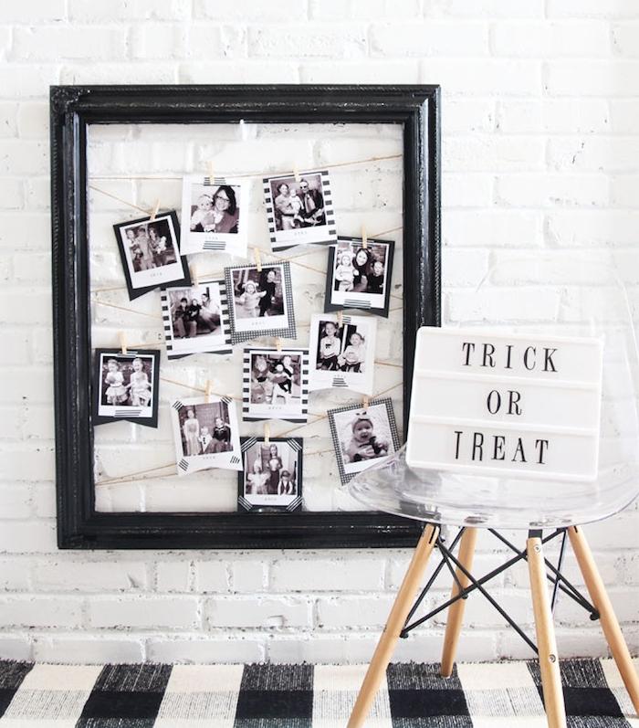 deco halloween a faire soi meme, un cadre, repeint en noir avec des photos pele mele en noir et blanc, chaise scandinave et tapis noir et blanc, mur en briques banches