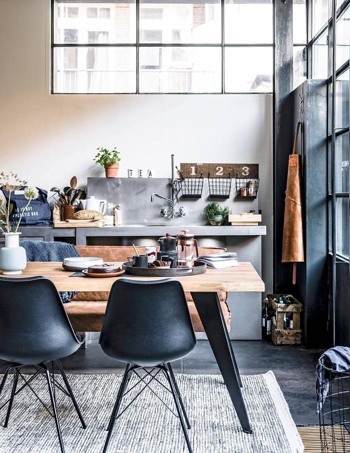 petite cuisine industrielle en béton aux accents déco rustiques avec un espace repas