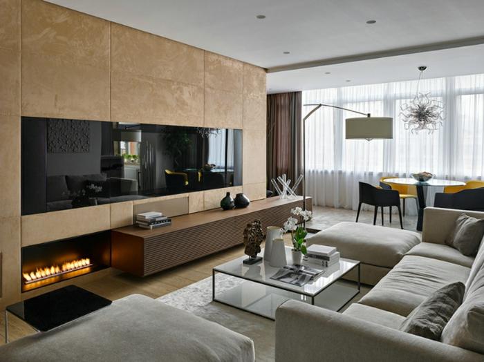 deco salon salle à manger, cheminée ouverte, table en verre, sofas gris, tapis couleur taupe, buffet moderne avec vitrine