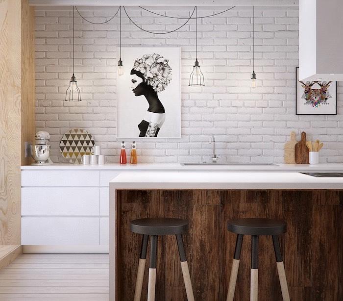 meuble bas cuisine, mur en briques blanc avec cordes électriques en style industriel, peintures décoratives à design femme et animal