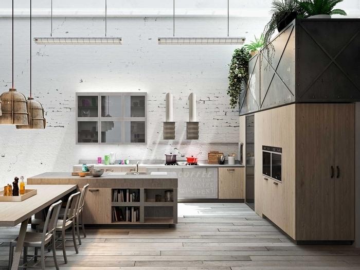 une cuisine d'ambiance loft industriel ensoleillée et spacieuse avec des murs en briques blanches et des luminaires d'usine