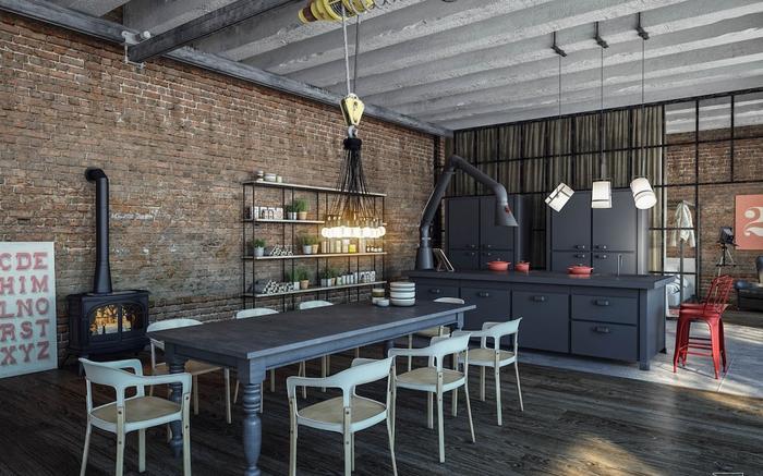 cuisine de style loft industriel au design brut et contemporain associant le béton, le métal noir mat