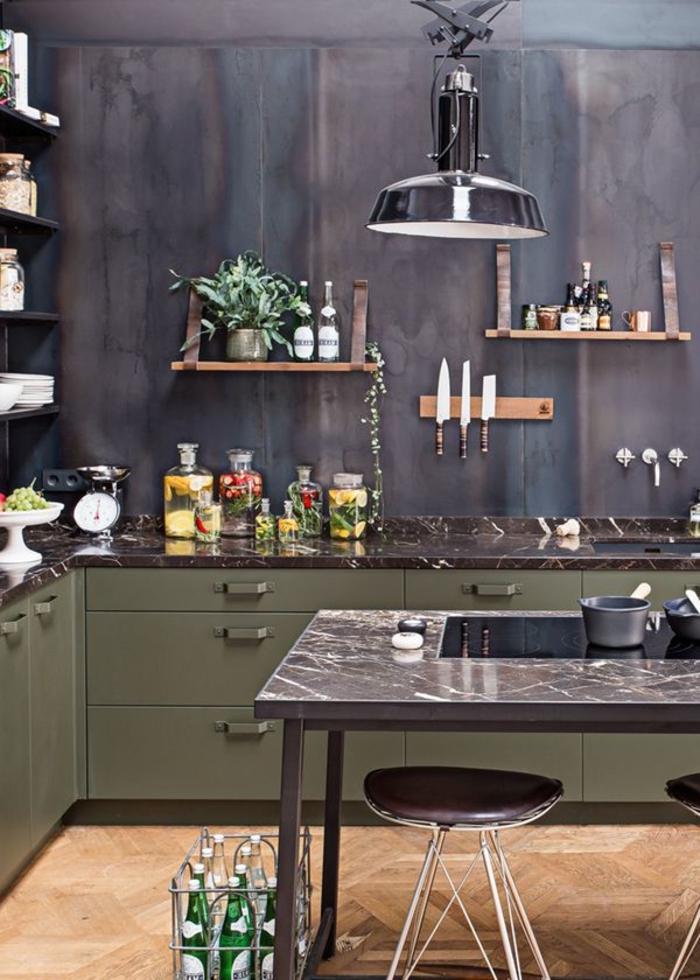 l'esthétique sobre et élégante de la deco industrielle dans une cuisine en noir et vert
