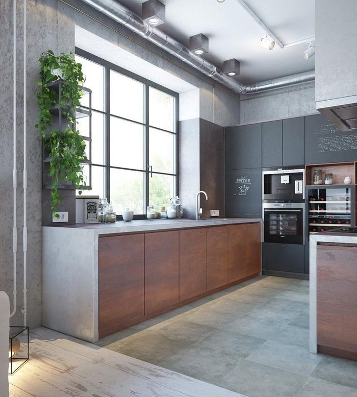 cuisine esprit loft industriel avec placards à finition gris mat équipé d un îlot central en bois et béton