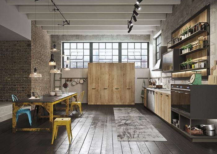 une cuisine d'esprit loft industriel aménagée en longueur, associant le bois et le métal pour une ambiance à la fois chaleureuse et authentique