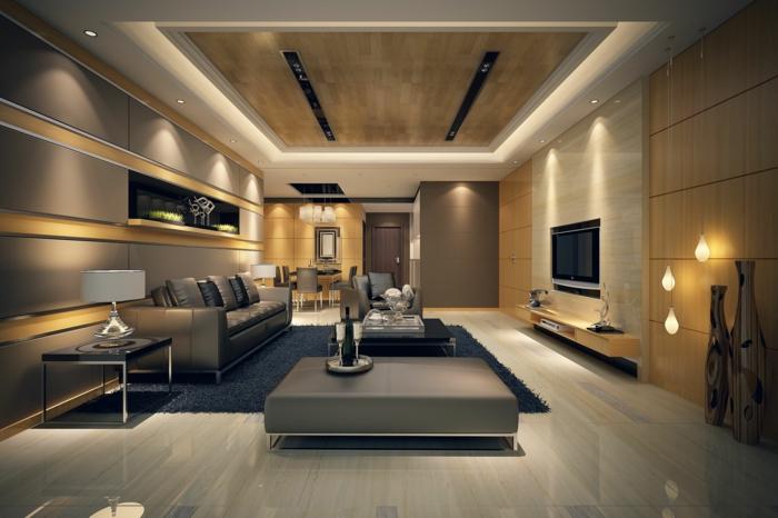 déco salon cocooning, salon luxueux, faux plafond lumineux, tapis bleu, sofa gris, lampes suspendues