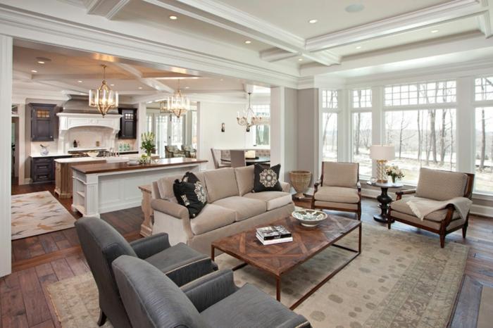 déco salon salle à manger, tapis beige, table basse industrielle, fauteuils confortables, plafond blanc