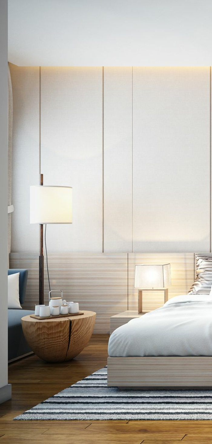 idee deco chambre avec meuble table basse en forme de tronc d arbre chambre au plafond haut avec un tapis rectangulaire sous le lit en bleu blanc et beige