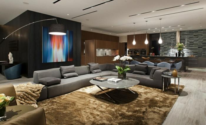deco salon moderne, table basse, grans canapé d'angle couleur gris, lampadaire de sol