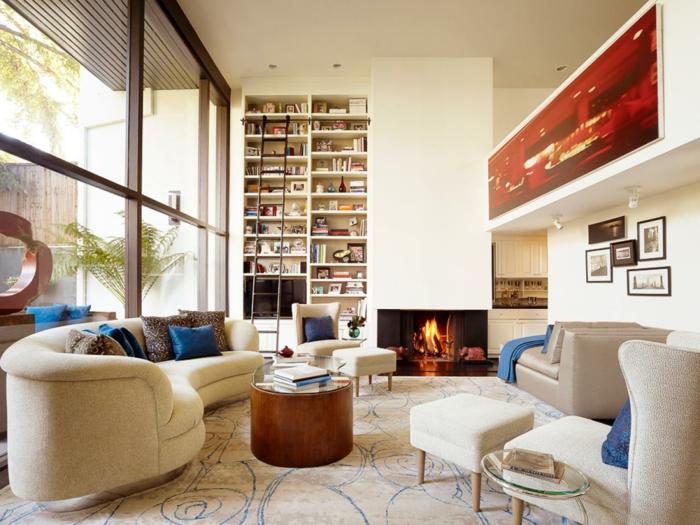 deco salon zen, bibliothèque-intégrée-table-basse-ronde-cheminée-murale-intégrée-sofa-à-formes-ovales
