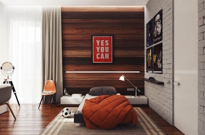 idee deco chambre garcon, plafond blanc avec mur en pierre gris, poster inspirant en rouge avec lettres blanches