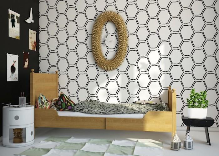 modele de papier peint géométrique, style graphique dan sune chambre a coucher moderne, pan de mur noir, lit bois, coussins colorés, tapis blanc et vert, table de nuit blanche