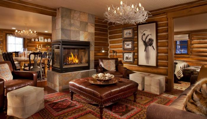 idée decoration salon, cheminée murale, revêtement mural en bois, tabourets beiges, salon et salle à manger style chalet