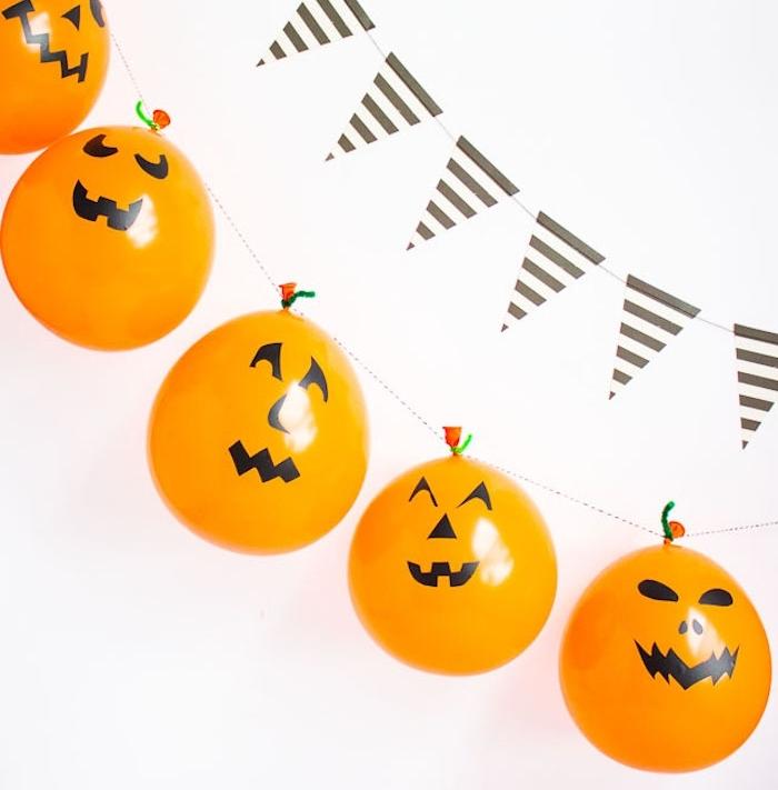 fabriquer une guirlande à partir de ballons couleur orange jack o lantern, rangés sur une ficelle, guirlande à fanions, deco halloween a faire soi meme