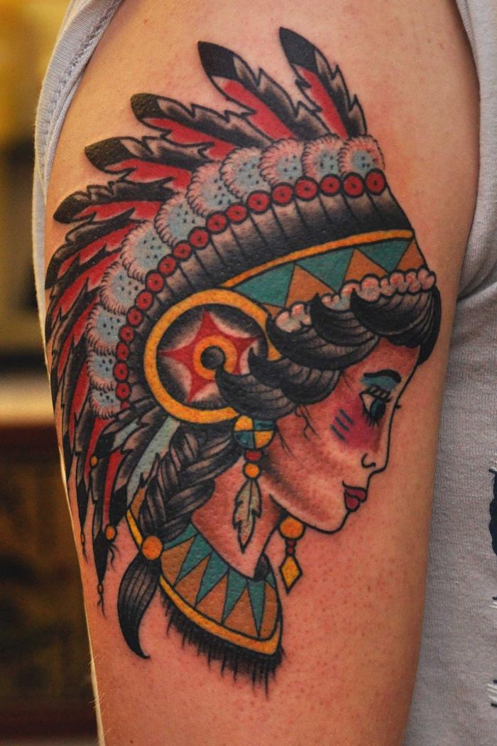 signification tatouage, art corporel pour homme et femme, dessin en couleurs sur le bras