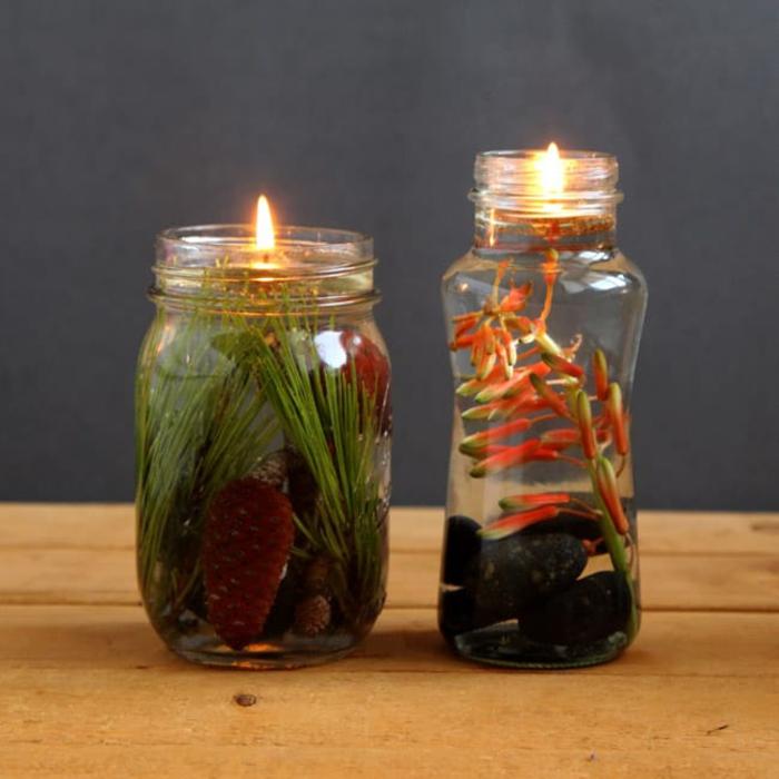 lampe bocal à huile végétale et à mèche flottante décorée de plantes et de galets