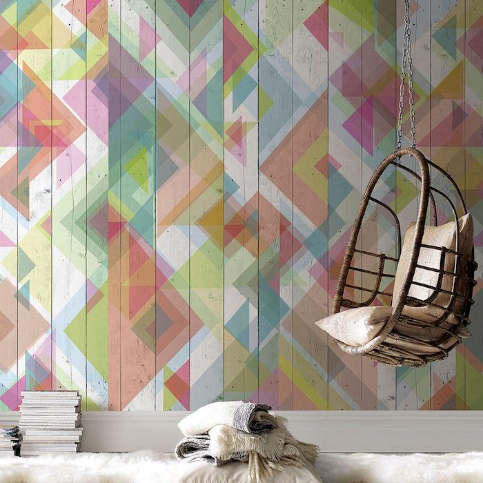 papier peint tendance, formes géométriques colorées, balançoire en bois suspendue, tapis blanc, pile de magazines