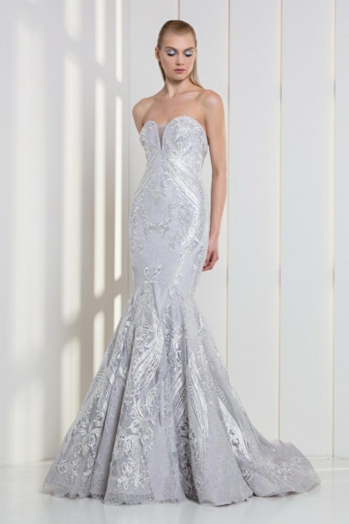 tenue de mariage robe ceremonie femme avec bustier couleur blanche richement ornée
