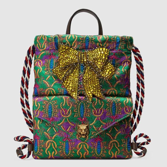 sac à dos femme tendance en style ethno Moschino avec grand noeud papillon aux paillettes jaunes