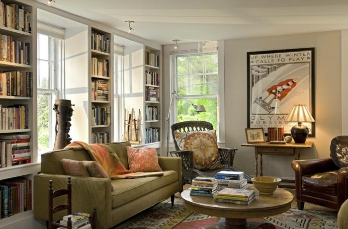 salon cocooning, table ronde de salon, sofa vert, coussins, grand poster encadré, tapis bariolé