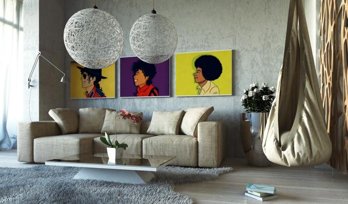 salon cosy, luminaires boules et tapis rectangulaire gris, table blanche, chaise hammac suspendue