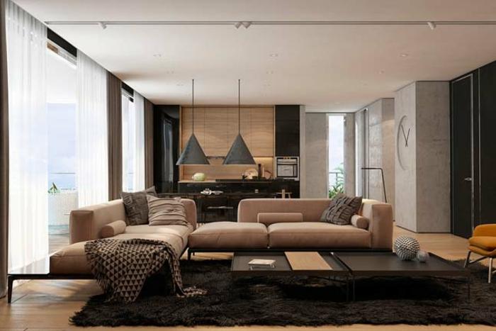 salon cosy, sofa beige, lampes pendantes, table basse, tapis noir, plafond blanc