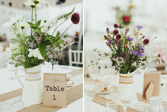 broc blanc transformé en vase de fleurs avec bouquet de fleurs champetre dedans, chiffre table sur papier kraft avec decoration de dentelle