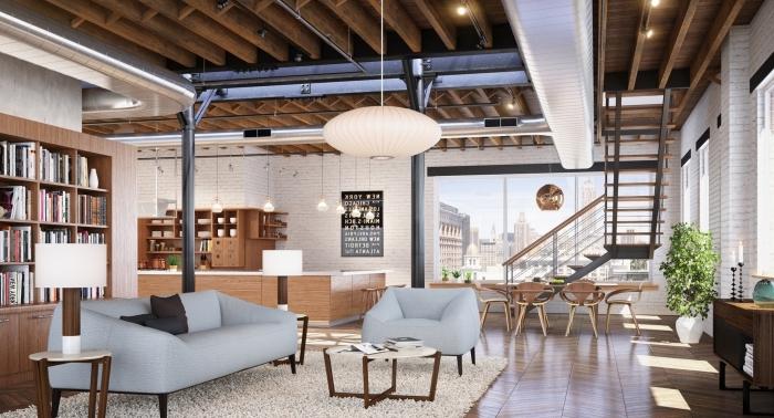 suspension luminaire, salon loft avec canapé et fauteuil en bleu clair, plancher en bois stratifié avec tapis moelleux blanc