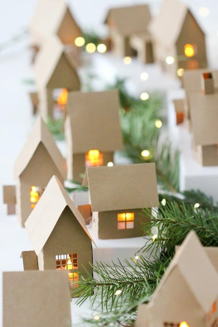 bricolage de Noel créatif, petites maisons illuminées à l'intérieur avec des lampes led