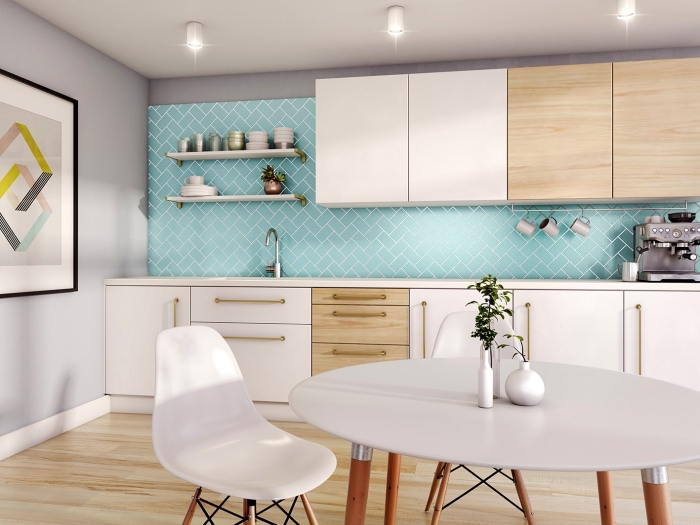 tableau scandinave, murs peints en gris clair avec revêtement de sol en bois stratifié, meubles de cuisine en bois et blanc