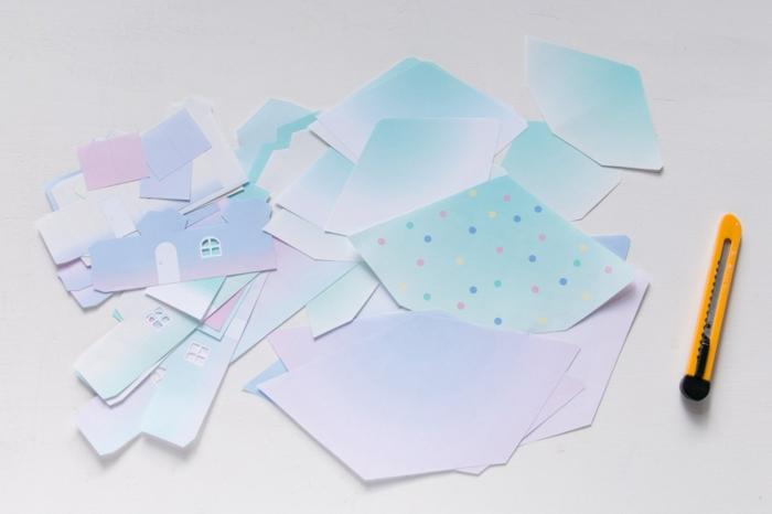 calendrier de l'avant, figures en papier blanc formant des maisons pour un village miraculeux
