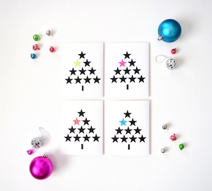 carte de noel maternelle en papier blanc avec des étoiles adhésifs noires et colorés, clochettes et boules de noel