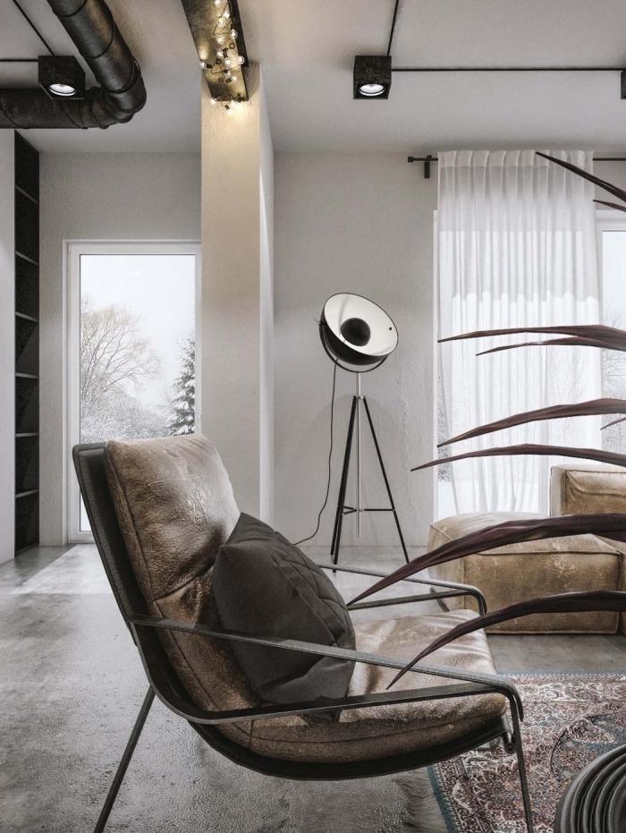 decoration d interieur, tabourets et canapé en velours beige avec tapis à motifs ethniques, salon aux murs blancs avec tuyaux apparents en noir