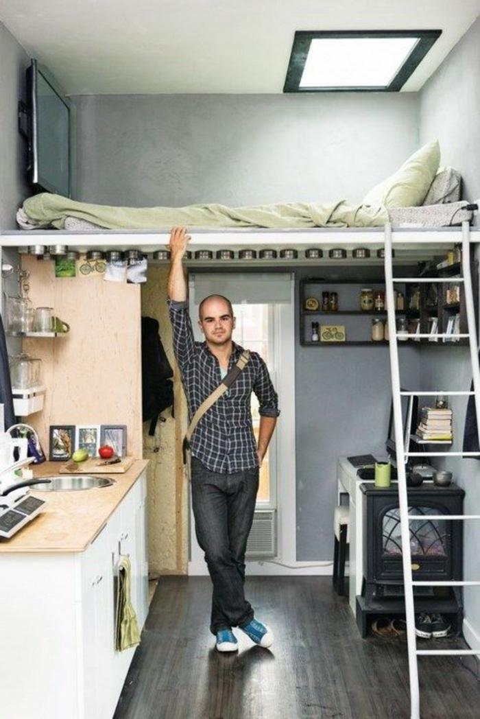 décoration chambre adulte chambre de 9m2 revêtement du sol en bois PVC gris anthracite, cuisine avec plan de travail en beige clair