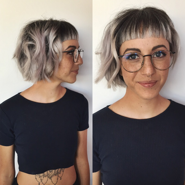 une coiffure femme frange et carré wavy qui joue sur le contraste des longueurs wavy et la frange lisse